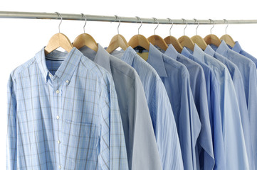 Close-up rack shirts isolated on white