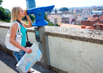 woman tourist and panorama binoculars