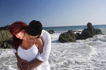 Young Couple at the beach kissing