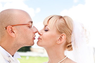 Happy young couple of bride and groom kissing