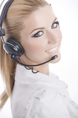 Beautiful business woman wearing a headset