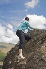 Girl Climbing a Rock