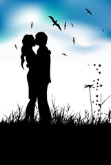 Couple kissing on summer meadow, black silhouette