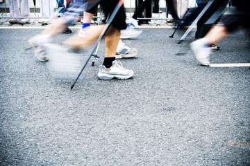 Nordic walking race, motion blur Wall mural