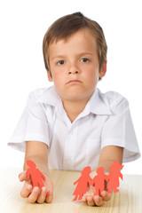 Sad kid with paper people in hands - divorce concept