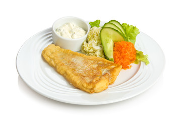 Fried fish with sauce and vegetable side dish