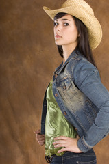 Cowgirl in green and jeans