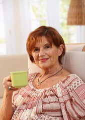 Portrait of senior woman drinking coffee