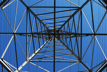 Looking up at power transmission tower