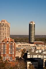 Three Condo Towers around Shopping Center