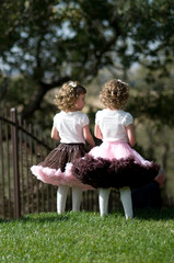 twin toddler girls in pretty skirts