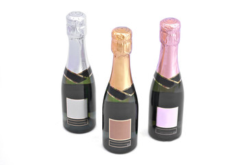 three champagne bottles in formation