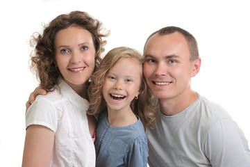 beautiful happy family of three laughing
