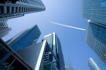 Office Building  and the high flying passenger plane with a cont
