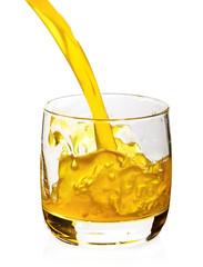 orange juice pored in glass