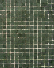 dark green tiles mosaic pattern on a wall