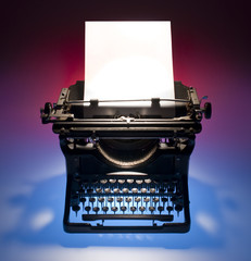 Vintage typewriter and paper