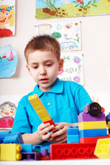 Child playing block and construction set.