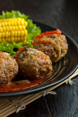 Meetballs served with corn and lettuce