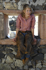 cowgirl and stone window