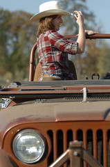 cowgirl and jeep