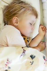 sleeping child with teddy bear