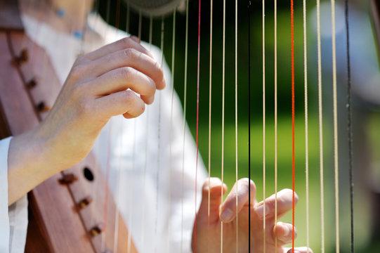Closeup of a Woman playing a Harp