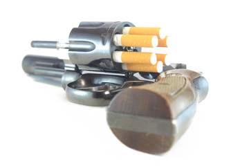 Revolver loaded with cigarettes symbolize dangers of smoking