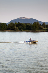 Aluminium Prints Water Motor sports Donau river with boat and castle