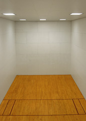 Empty Room with Wooden Floor and White Walls