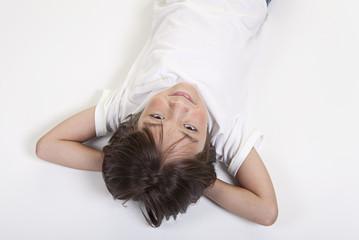 Girl lays on floor.