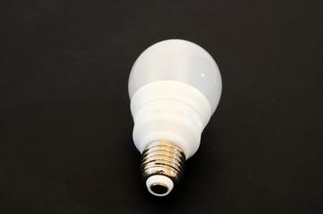 light bulb on dark black background