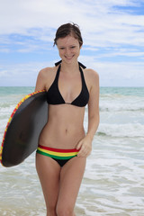beautiful girl at the beach with her boogieboard