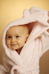 The little girl in bathrobe