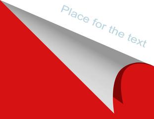 The bent corner of a paper
