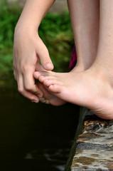 Hand touching feet