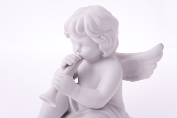 Porcelain angel playing trumpet