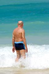 Senior man in water