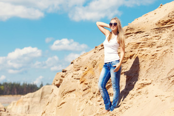 young girl the blonde in jeans