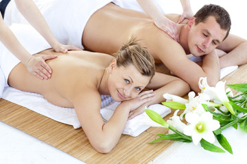 Affectionate young couple having a back massage