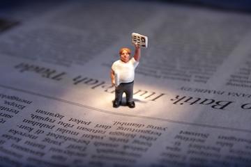 Newspaper Seller Figurine