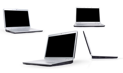 collection of four laptops on white background