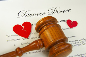 broken red hearts and legal gavel on divorce papers
