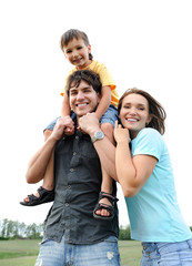 Happy beautiful young family posing outdoors