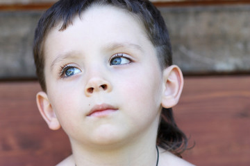 Closeup portrait of beautiful little boy
