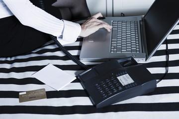 Woman phoning computing