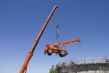 Very large crane lifting small crane