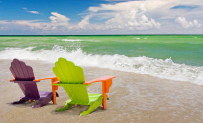 Colorful lounge chairs at a tropical beach in Miami Florida