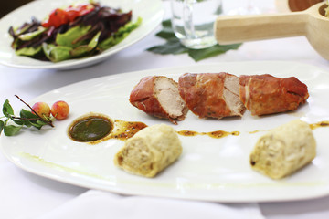 Rabbit wrapped in prosciutto with sauce and dumplings