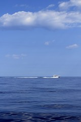 motorboat fisherboat cruising speed on blue sea